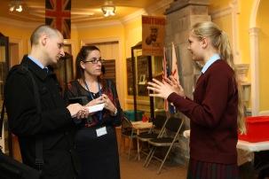 Marketing team talking to visitors