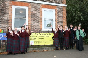 The Takeover Day pupils outside the museum with the banner they designed