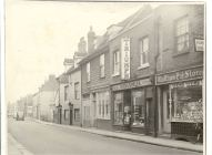 Row of shopfronts on south side of Sun Street, Waltham Abbey: including No. 15 Waltham Pet Stores with sign advertising fishing tackle above it and Dyer and Gowler, electrical goods shop