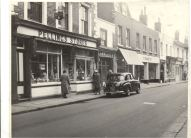 Row of shopfronts on north side of Sun Street, Waltham Abbey : including Pellings Stores, grocery and provisions shop and Francis, electrical goods shop