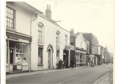 Shopfronts on north side of Sun Street, Waltham Abbey including Walshams artists suppliers, Roys greengrocers and a dairy