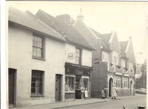 Row of buildings at north east end of Sun Street, Waltham Abbey including Clark's confectioners and tabacconists and The New Inn Public House: signs advertising Walls ice cream fixed to wall of Clark's