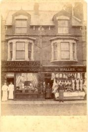 Photograph of International Tea Company and Waller's Butcher's Shop and Mr.Waller and assistant in Market Square with mount