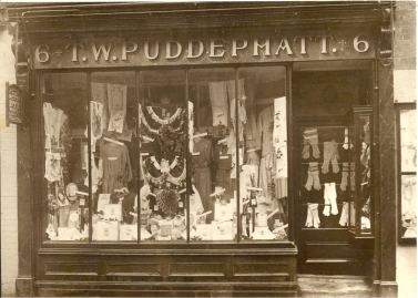Shop front of Puddephatt's drapers store 6, Sun Street, Waltham Abbey showing T.W.Puddephatt's shop and The Perth Dye Works